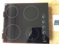 Ceramic side control hob.