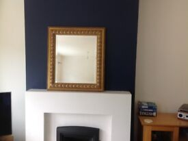 Decorated brass framed mirror for sale