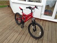 "Muddy fox kids mountain bike. Red with black 18"" wheels."