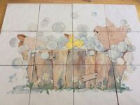 Tiled mural in pig design for bathroom.