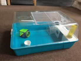 Hamster cage with assortment of food and toys £12