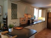 Kitchen - Shaker style kitchen with extensive variety of cupboards & appliances.