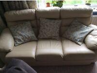 Three seater cream leather sofa .