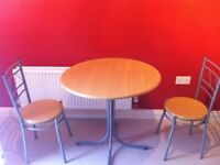 Dinning room table and 2 chairs excellent condition