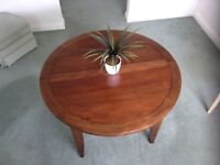 Dark wood circular dining table 46 inch diameter extending to 63 inches