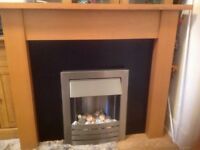 Electric fire with surround good clean condition all working size height 40 and a half inches by 48