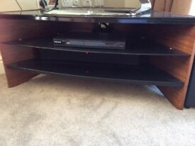 Tv unit fits a corner,black glass and walnut veneer.