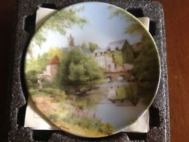 Brad ex Collectible plate, river scene in France.