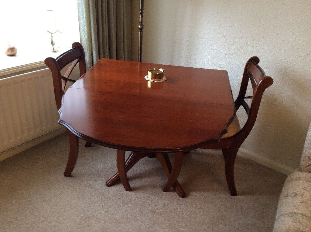 Dining table and 4chairs excellent condition and well cared for.