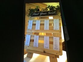 Handmade wooden 'find your seat' wedding sign and easel