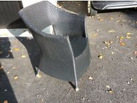 Black rattan chair.