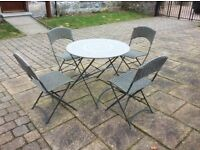 Metal garden table and 4 wicker type chairs