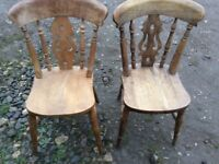 two fiddle back chairs