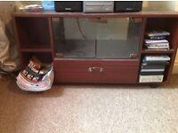 TV stand on wheels, w94 h49 d40 dark brown, shelf w glass doors, 4 small shelves, a drawer