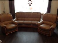 Leather sofa and two single chairs