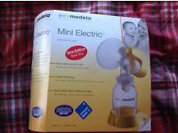 Medela mini electric breast pump, breast pads & lansinoh breast milk storage bags