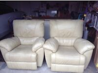 Two leather recliner armchairs (cream). All in good working order .
