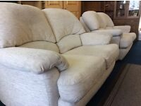 Two 2 seater sofas in cream material excellent condition