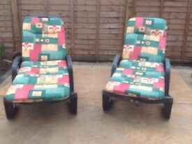Two relaxer reclining sunbeds with cushions and adjustable backs . Excellent condition