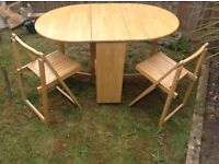 Free Table and 2 Chairs - pick up today.