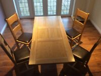 Pine Extending Dining Table and four leather based chairs for sale. In Good Condition.