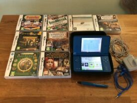 Nintendo DSI XL. With 8 games.