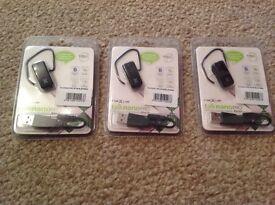 Three nexus talknanopro Bluetooth earpieces.