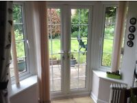 Vertical blinds to fit modern bay with French doors