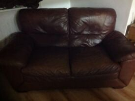 Two brown two seater sofas