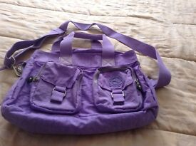 Handbag with detachable strap.