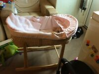 Pink Moses basket and mamas and papas rocking stand