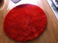Orange circle rug and cushions