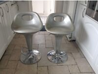 Two silver/grey stools