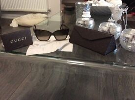Gucci ladies sunglasses never worn . Unwanted gift .