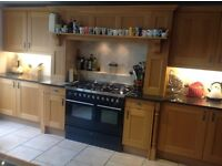Fully fitted solid oak kitchen with integrated appliances and granite worktops