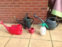 Group of assorted watering cans