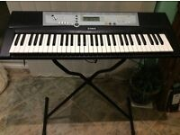 Yamaha YPT - 200 electric keyboard plus stand, case and music stand.