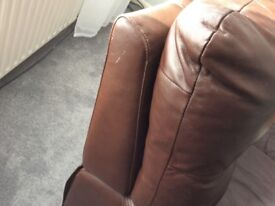 Two seater brown reclining sofa