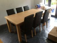 Solid oak extending table with 6 leather chairs