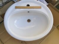 Two white bathroom basins, one approx 50 x 45cms, one 45 x 32cms, both unused and good quality