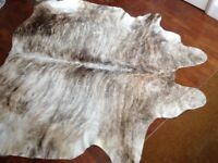 Cowhide rug in cream and brown