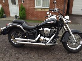 Kawasaki vn900 classic cruiser,outstanding condition with screen, sissy bar and leather side bags,