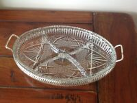 Glass pickle disk in silver plate tray