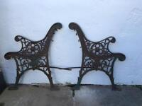 Two wrought iron seat ends