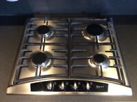 Neff stainless steel gas hob with four burners.
