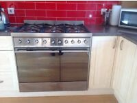 SMEG dual fuel range cooker with 6 gas rings and 2 electric ovens, the larger one, fan assisted.