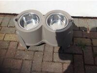 Dog feeding bowls on stand
