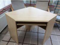 Corner desk unit in a beech finish.