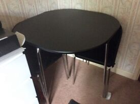 Compact table and 4 chairs , good for a small space as chairs tuck under table.