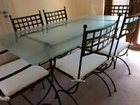 Black wrought iron table with frosted glass top & 6 chairs